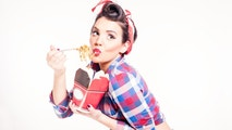 Beautiful pinup girl eating spaghetti portion