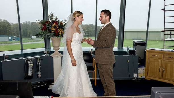 PIC BY Capture Every Moment Photography / CATERS NEWS -(PICTURED a couple in the control tower PIC TAKEN 24/10/17 ) Couples with a head for heights can now get married on the worlds first licensed Boeing 747 party plane. Cotswold Airport, near Gloucestershire, has been given a licence to perform civil wedding ceremonies and naming ceremonies aboard its Boeing 747 plane and in their operational control tower  the only such venues in the world. The unique plush plane will see brides walking down a very different kind of aisle as they prepare to exchange vows in the huge commercial airliner. The aircraft took seven months to transform and despite some of the original decor, including the seating numbers still being visible, the plane can be styled in lots of different ways just like a normal wedding venue. Because of the vast space on-board, staff can also set up stages, makeup rooms and dressing rooms, all separate from the main area. SEE CATERS COPY