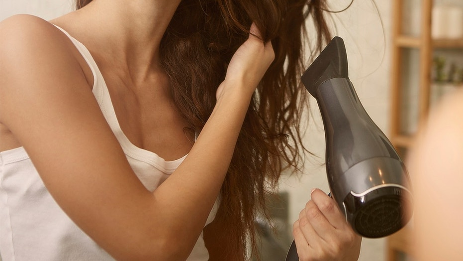 "A woman claims her brand new hair dryer became a ""blow torch"" and burned her hand."