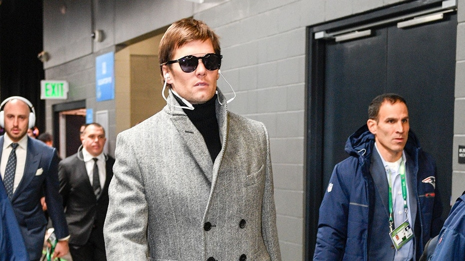 """Brady was also likened to a Bond villain, and many users thought he looked like """"three kids standing on each other's shoulders."""""""