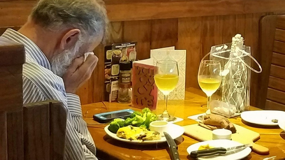 Heartbreaking photo shows man eating across from wife's ashes on Valentine's Day