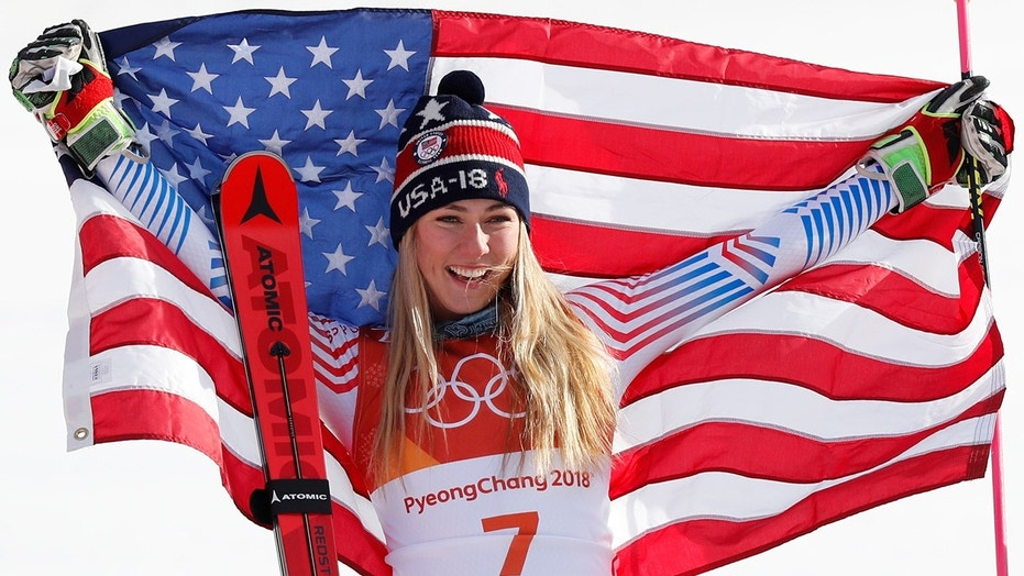 Women's Giant Slalom gold medalist Mikaela Shiffrin of the U.S. celebrates during the Olympic victory ceremony in Pyeongchang.