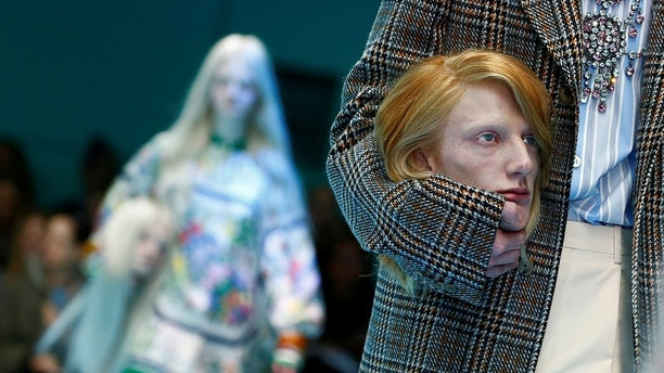 A model presents a creation from the Gucci Autumn/Winter 2018 women collection during Milan Fashion Week in Milan, Italy February 21, 2018. REUTERS/Tony Gentile - RC1A65FF63C0