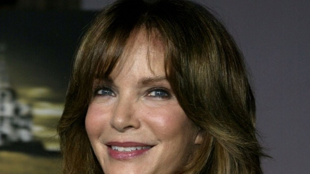 """Actress Jaclyn Smith poses for photographers as he arrives as a guest for the premiere of the new film """"Cold Creek Manor"""" which stars [Sharon Stone and Dennis Quaid] in Hollywood September 17, 2003.  [Stone and Quaid play husband and wife who move to a house in New York state and the terrifying incidents that then take place.] The film opens September 19 in the United States. - PBEAHUONDAO"""