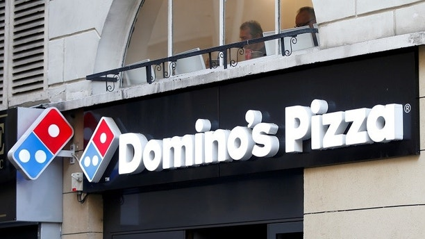 FILE PHOTO: The sign of a Domino's Pizza restaurant is seen in Paris, France, October 27, 2016. REUTERS/Charles Platiau/File Photo                      GLOBAL BUSINESS WEEK AHEAD         SEARCH GLOBAL BUSINESS FOR ALL IMAGES? - RC195F0530A0