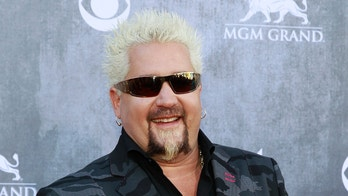 Celebrity chef Guy Fieri arrives at the 49th Annual Academy of Country Music Awards in Las Vegas, Nevada April 6, 2014.    REUTERS/Steve Marcus (UNITED STATES  - Tags: ENTERTAINMENT FOOD)    (ACMAWARDS-ARRIVALS)