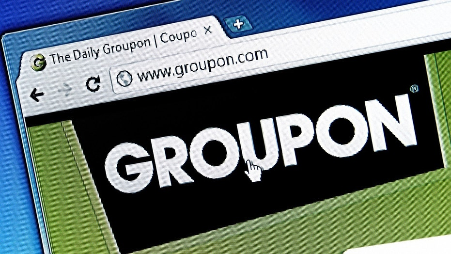 Groupon has apologized after ads with racial slurs appeared on the site.