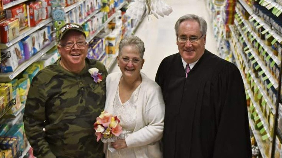 Larry Spiering and Becky Smith tied the knot in aisle 13 of the Community Supermarket in Lower Burrell, Penn.