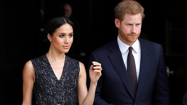 Britain's Prince Harry and his fiancee Meghan Markle leave a service at St Martin-in-The Fields to mark 25 years since Stephen Lawrence was killed in a racially motivated attack, in London, Britain, April 23, 2018. REUTERS/Peter Nicholls - RC1E027934F0