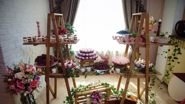 Candy bar. Table with sweets, buffet with cupcakes, candies dessert