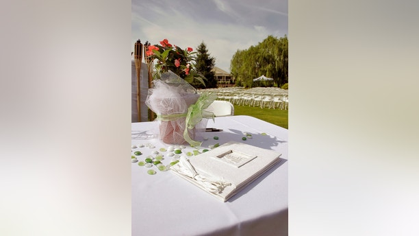 Guest Book for wedding. Chairs in background.