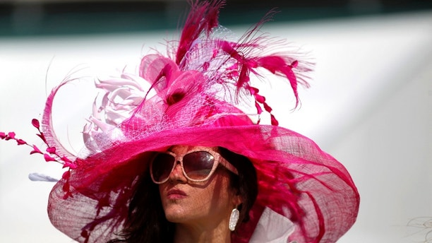 May 7, 2016; Louisville, KY, USA; Horse racing fan Ellen Palmer wears a derby hat in the infield during the 142nd running of the Kentucky Derby at Churchill Downs. Mandatory Credit: Aaron Borton/Louisville Courier-Journal via USA TODAY NETWORK  / Reuters  Picture Supplied by Action Images *** Local Caption *** 2016-05-07T173630Z_1993285762_NOCID_RTRMADP_3_HORSE-RACING-142ND-KENTUCKY-DERBY.JPG - MT1ACI14372975