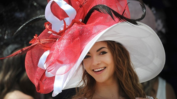 May 7, 2016; Louisville, KY, USA; Monique Rosteing poses with her derby hat before the 142nd running of the Kentucky Derby at Churchill Downs. Mandatory Credit: David Lee Hartlage/Louisville Courier-Journal via USA TODAY NETWORK  / Reuters  Picture Supplied by Action Images *** Local Caption *** 2016-05-07T195700Z_503845270_NOCID_RTRMADP_3_HORSE-RACING-142ND-KENTUCKY-DERBY.JPG - MT1ACI14373313