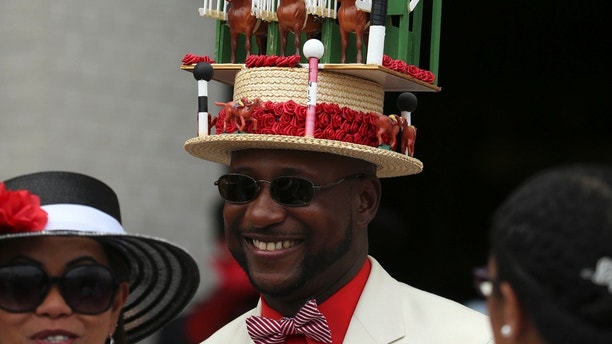 May 7, 2016; Louisville, KY, USA; A patron wears a decorated derby hat before the 142nd running of the Kentucky Derby at Churchill Downs. Mandatory Credit: Mark Zerof-USA TODAY Sports  / Reuters  Picture Supplied by Action Images *** Local Caption *** 2016-05-07T172857Z_939336150_NOCID_RTRMADP_3_HORSE-RACING-142ND-KENTUCKY-DERBY.JPG - MT1ACI14372953