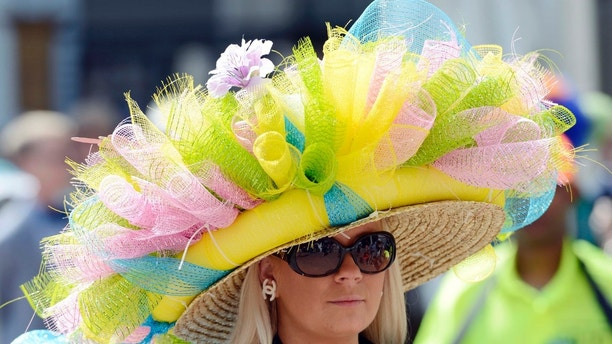 May 3, 2014; Louisville, KY, USA; Ashley Cebak wears a derby hat before the 2014 Kentucky Derby at Churchill Downs. Mandatory Credit: Jamie Rhodes-USA TODAY Sports - 7896914