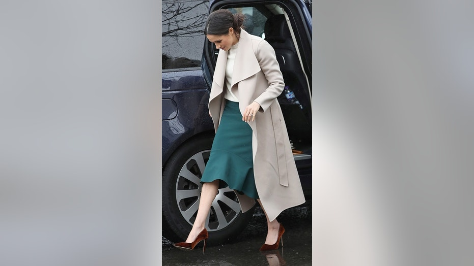Markle paired a $750 Mackage coat with a pair of velvet Jimmy Choos during a March visit to Northern Ireland.