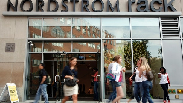 People walk past the Nordstrom Rack store, in New York's Union Square, May 21, 2010.  This month's opening of the Nordstrom Rack store in the heart of Manhattan shows just how far outlet stores have come, from being distant outposts for liquidating unsold inventory to taking center-stage in retailers' growth strategies. To match Analysis: USA-RETAIL/OUTLETS  Picture taken May 21, 2010. REUTERS/Chip East (UNITED STATES - Tags: BUSINESS) - GM1E65N1QUP01