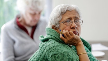 In this Friday, April 13, 2018 photo, Sara Dhamija, right, listens to a teacher during an anti-bullying class at the On Lok 30th Street Senior Center in San Francisco. Nursing homes, senior centers and housing complexes for the elderly have introduced programs, training and policies aimed at curbing spates of bullying, an issue once thought the exclusive domain of the young. (AP Photo/Marcio Jose Sanchez)