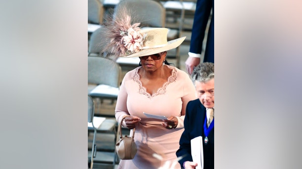 Oprah Winfrey arrives for the wedding ceremony of Prince Harry and Meghan Markle at St. George's Chapel in Windsor Castle in Windsor, near London, England, Saturday, May 19, 2018. (Danny Lawson/Pool Photo via AP)