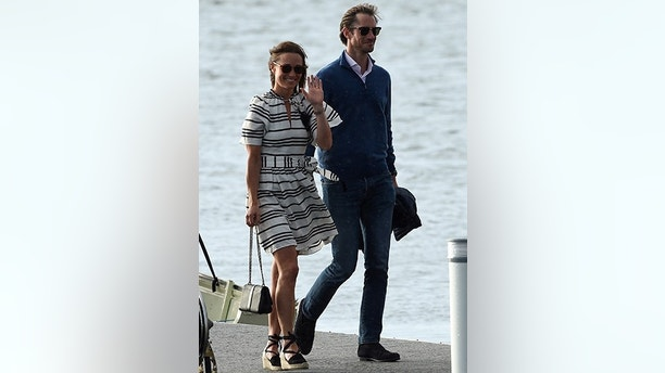 Pippa Middleton (L) and her husband James Matthews (R) arrive at Rose Bay Wharf by sea plane in Sydney on May 31, 2017.Pippa and Matthews, who married on May 20, 2017, are visiting Sydney on their honeymoon.  / AFP PHOTO / SAEED KHAN        (Photo credit should read SAEED KHAN/AFP/Getty Images)