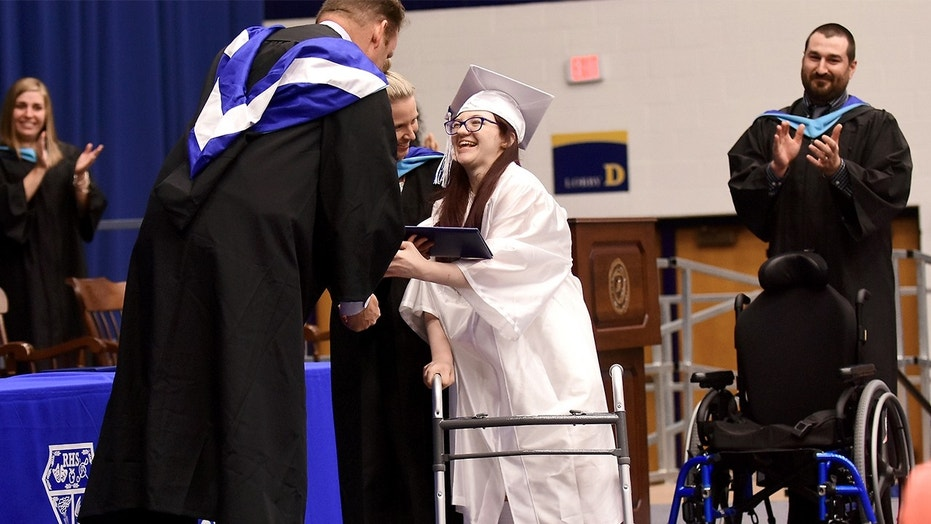 Lexi Wright left her chair and walked across the stage and down the ramp to accept her diploma at Ravenna High School's graduation on Wednesday, May 30, 2018, at Kent State University in Kent, Ohio, to a standing ovation. The Ohio teenager has cerebral palsy and was never expected to be able to walk has shocked her family by doing just that at her high school graduation.