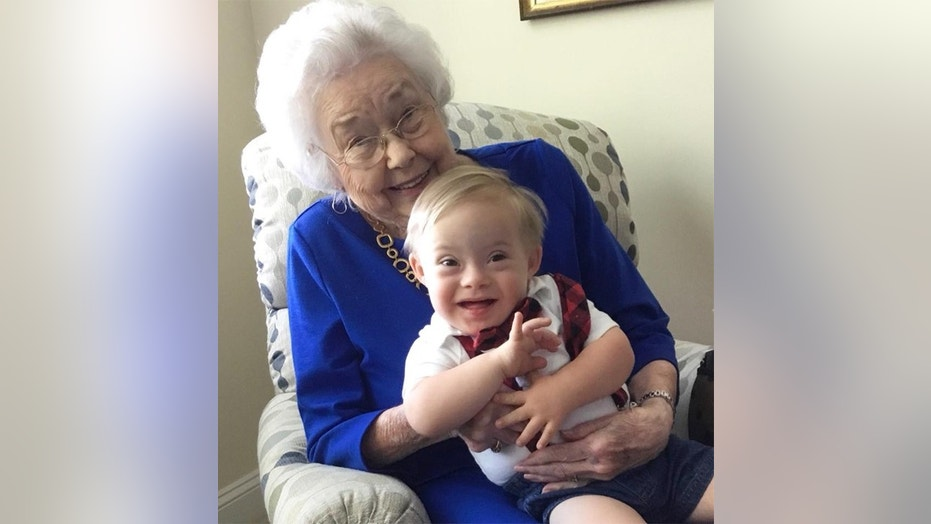 The original Gerber Baby and newest Gerber Baby just met and posed for the cutest pic together.