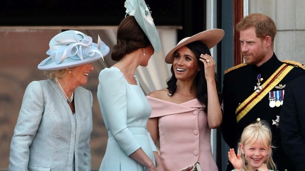 From left, Camilla Duchess of Cornwall,Kate Duchess of Cambridge, Meghan Duchess of Sussex and Prince Harry, on the balcony of Buckingham Palace, in central London, following the Trooping the Colour ceremony on Saturday, June 9, 2018. (Yui Mok/PA via AP)