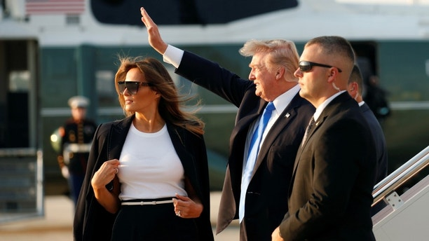 U.S. President Donald Trump and first lady Melania Trump board Air Force One as they depart Joint Base Andrews in Maryland, U.S., enroute to Paris July 12, 2017.  REUTERS/Kevin Lamarque - RC16E359AA00