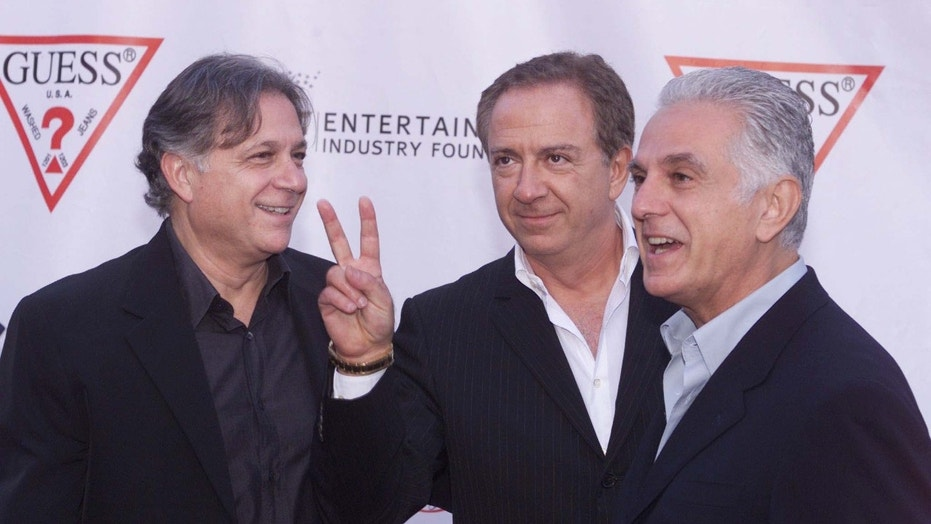 Armand (L) Paul (C) and Maurice Marciano, founders of the Guess clothing line, pose as they arrive at their company's 20th anniversary party in Los Angeles, May 9, 2002.