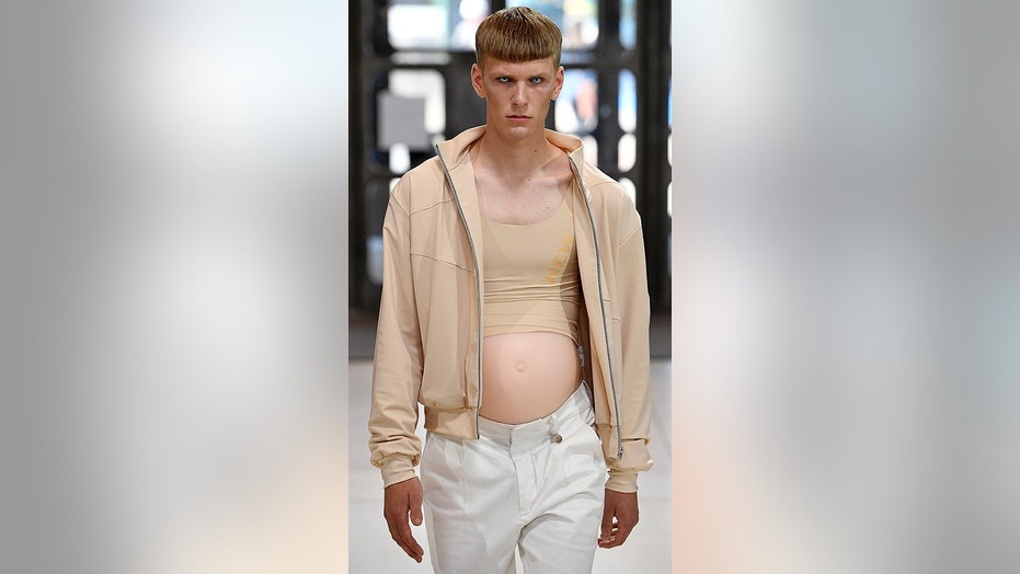 A male model showed off fashion and a belly on Monday during London Fashion Week.