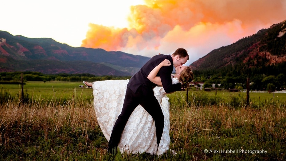 One couple's vivid wedding photo with Fire 416 in the background has gone viral on social media.