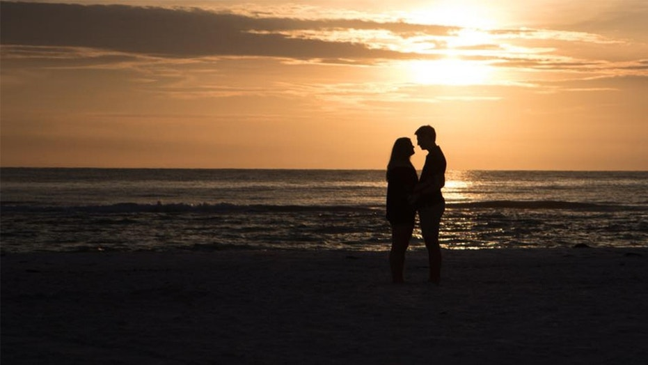 A photographer tracked down an unknown couple after she captured their proposal on camera.