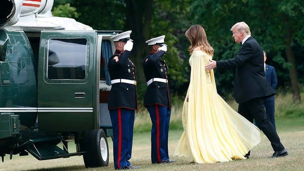 President Donald Trump and first lady Melania Trump prepare to board Marine One helicopter as they leave Winfield House residence of the U.S. Ambassador for the flight to nearby Blenheim Palace Thursday