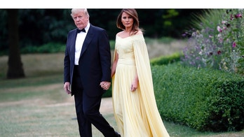 President Donald Trump and first lady Melania Trump leave Winfield House, residence of the U.S. Ambassador, before boarding Marine One helicopter for the flight to nearby Blenheim Palace, Thursday, July 12, 2018, in London. (AP Photo/Pablo Martinez Monsivais)