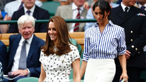 Kate, Duchess of Cambridge and Meghan, Duchess of Sussex, right, arrive in the Royal Box on Centre Court ahead of the women's singles final match between Serena Williams of the US and Angelique Kerber of Germany at the Wimbledon Tennis Championships, in London, Saturday July 14, 2018. (Nic Bothma, Pool via AP)