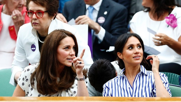 Kate, Duchess of Cambridge and Meghan, Duchess of Sussex, right, sit in the Royal Box on Centre Court ahead of the women's singles final match between Serena Williams of the US and Angelique Kerber of Germany at the Wimbledon Tennis Championships, in London, Saturday July 14, 2018. (Nic Bothma, Pool via AP)