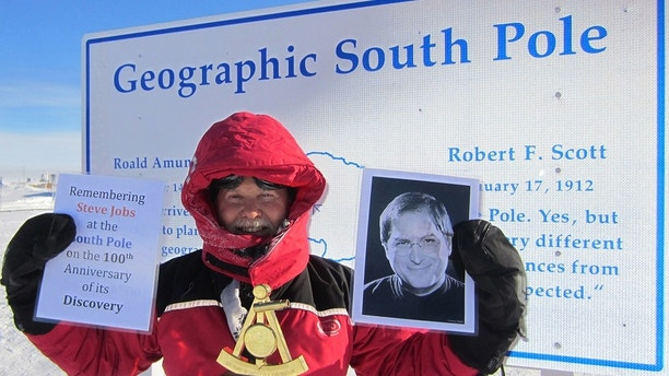 Pic by Caters News - (Pictured: Don Parrishs tribute to Steve Jobs at the South Pole in 2011..) -THE worlds most well-travelled man has been to an incredible 852 places across the globe - but still has 23 to go. Don Parrish was officially named as the number one in most travelled people back 2013 after reaching Conway Reef off Fiji. To get to the remote spot, which is around 450km away from the main islands, he chartered a boat along with another traveller. It certainly wasnt the first time Don had chartered a boat. In fact he has visited 60 islands by ship as that is the only way to get there. His incredible journey to Conway Reef is one of hundreds which have seen him visit all 26 cantons in Switzerland, all 16 states in Germany and all 85 political subdivisions in Russia over 13 visits. His trip to North Korea even made front page news as he was one of the first US tourists in the country for a number of years. SEE CATERS COPY.