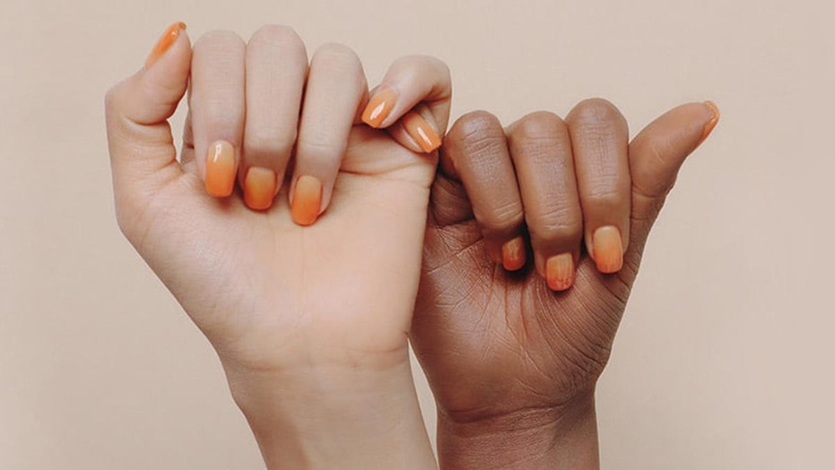 A South Korean beauty company has been accused of racism after posting an ad with a black hand and a white hand.