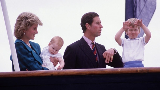 VENICE - May 5: Diana Princess of Wales and Charles Prince of Wales hold Prince Harry and Prince William on the deck of the Royal Yacht Britannia, during the Royal Tour of Italy on May 5, 1985 in Venice Italy. Princess Diana wore a coat designed by Emmanuel. (Photo by David Levenson / Getty Images)