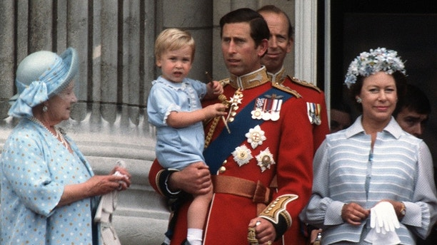 LONDON, UNITED KINGDOM - JUNE 16:  Prince Charles, Prince of Wales holds young Prince William on the balcony of Buckingham Palace following the Trooping the Colour ceremony on June 16, 1984 in London, England. (Photo by Anwar Hussein/Getty Images)