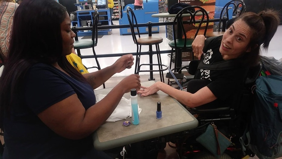 A Walmart employee has been praised online for her act of kindness.