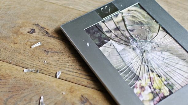 Wedding picture frame broken on floor