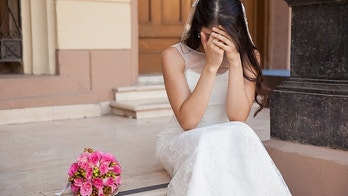 Hopeless bride crying outside a church after being stood up on her wedding day