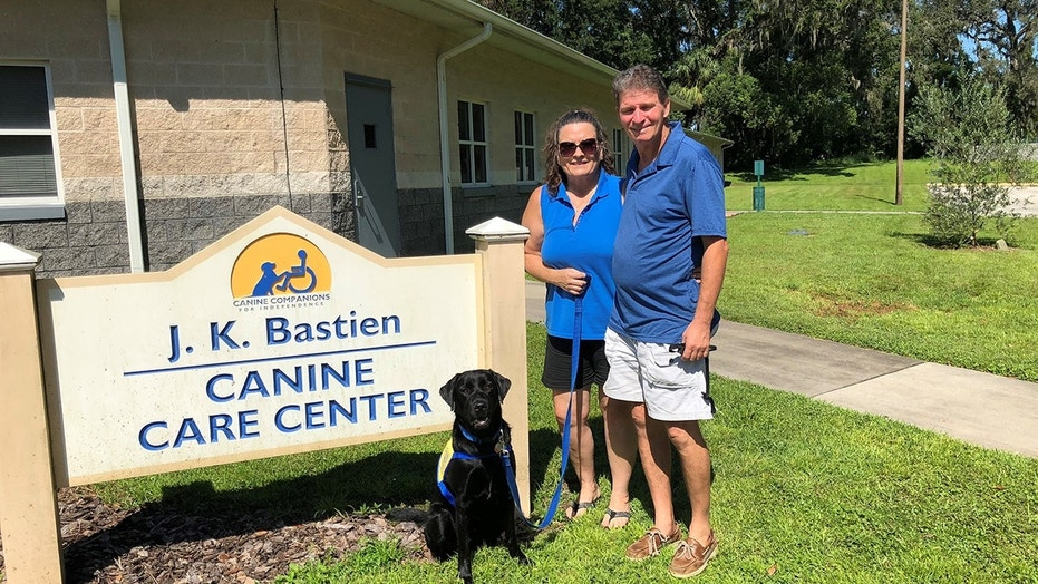 Puppy-raisers Kelly and Steve Shelton needed a place to go when the hurricane hit, and the Canine Companions facility in Orlando was happy to help.