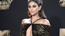 Shay Mitchell arrives at the MTV Movie and TV Awards at the Shrine Auditorium on Sunday, May 7, 2017, in Los Angeles.