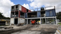 September 18, 2018 - Davie, Florida, USA - Architect Asghar Fathi is building a three-story home out of eight former shipping containers in Davie. When done in about two to three months, the house will have three bedrooms, a living room, kitchen, dining area, a studio, a two-car carport and an open-air deck. He plans to live in the 3,000 square foot house with his wife and son. He estimates the project will cost about 50,000 by the time he'Äôs done. 'ÄúIt'Äôs recycling basically,'Äô'Äô he said of the cargo containers which he bought for ,500 each at an Opa-locka container yard. 'ÄúI want to make an example of it. It'Äôs my own home. I am going to live in it.'Äù..Taimy Alvarez / South Florida Sun Sentinel  (Credit Image: © Sun-Sentinel via ZUMA Wire)