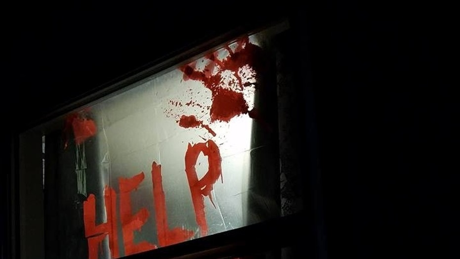 "Becky Muhs' ""Help Me"" decoration proved to be just a bit too scary for the neighbors."