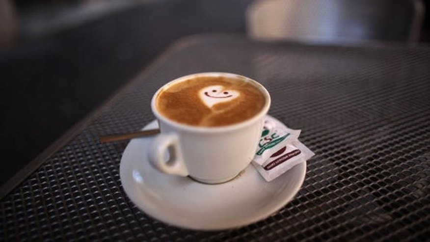 ROME - JULY 09:  A smiley face and heart adorns the froth of a cappucino reflecting the romance of Rome on July 9, 2009 in Rome, Italy. With nearly 3000 years of history Rome continues to live up to its motto of The Eternal City for being one of the founding cities of Western Civilisation.  (Photo by Christopher Furlong/Getty Images)