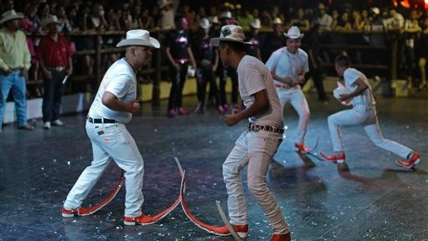 "In this picture taken Saturday, May 7, 2011, the ""Aliados"" dance crew performs at the Mesquit Rodeo nightclub during a dance competition in Matehuala, Mexico, Saturday, May 7, 2011. The dance crews were the first to embrace the flashy pointy boot-craze that has swept through the Mexican town of Matehuala, spread to nearby cities and even taken by migrants across the border into the United States. (AP Photo/Dario Lopez-Mills)"