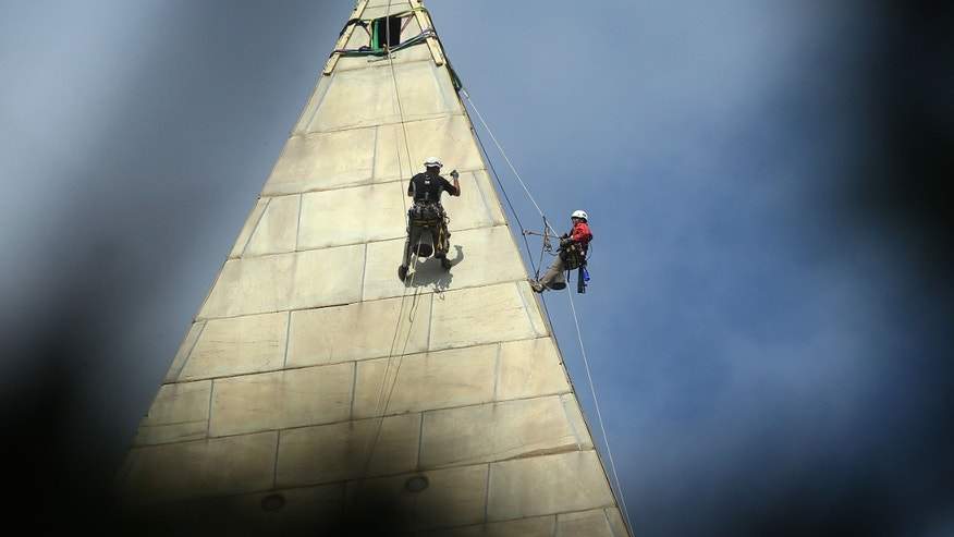 WASHINGTON, DC - SEPTEMBER 28:  Engineers begin the process of conducting a block-by-block inspection of the exterior of the Washington Monument while suspended by ropes September 28, 2011 in Washington, DC. The National Park Service has closed the landmark in the nation's capital indefinitely due to damage caused by a 5.8 magnitude earthquake in August  (Photo by Mark Wilson/Getty Images)